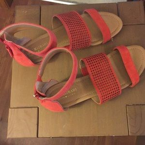 Coral red ankle strap flat sandals. Zipper backs.